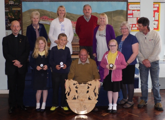 The beautifully carved plaque by John Evans was presented to Fochriw School on the 21st May 2013.  Carved with drawings from 3 of the children who attend Fochriw School, showing part of Fochriw's history.